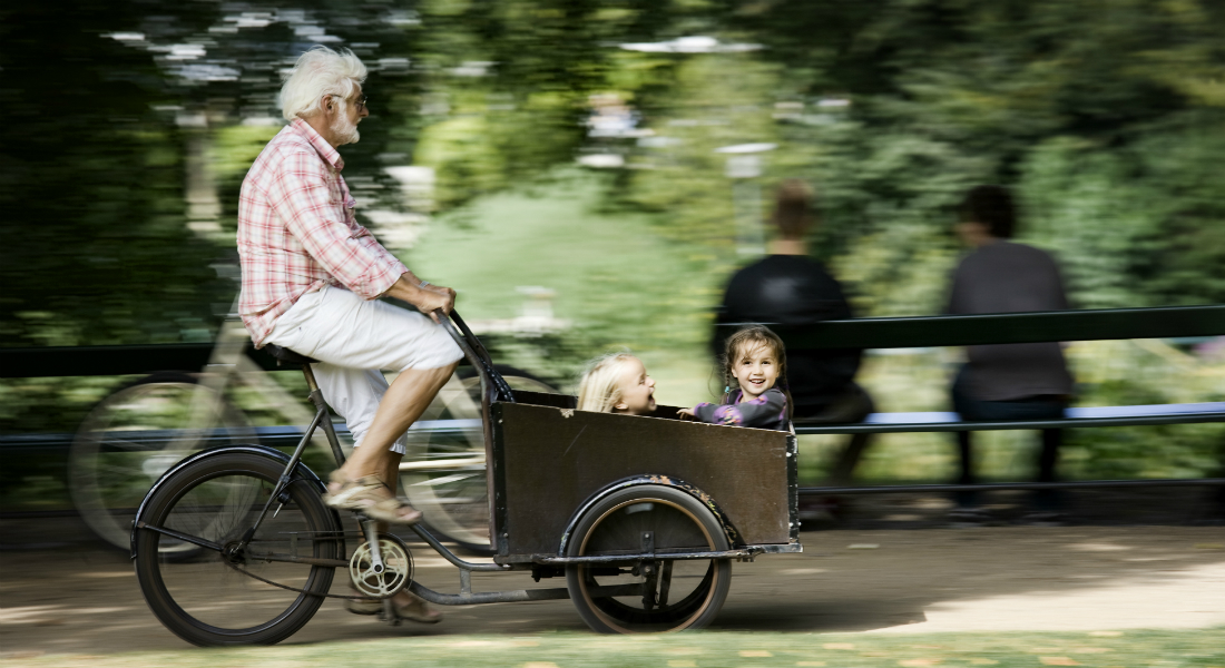 Man on bike with kids